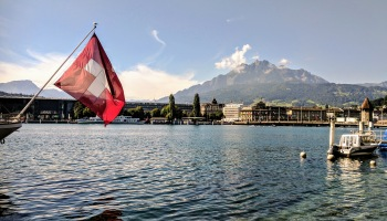 Swiss flag with Mt Pilatus in background